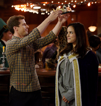 Image shows Jake placing a crown on Amy's head
